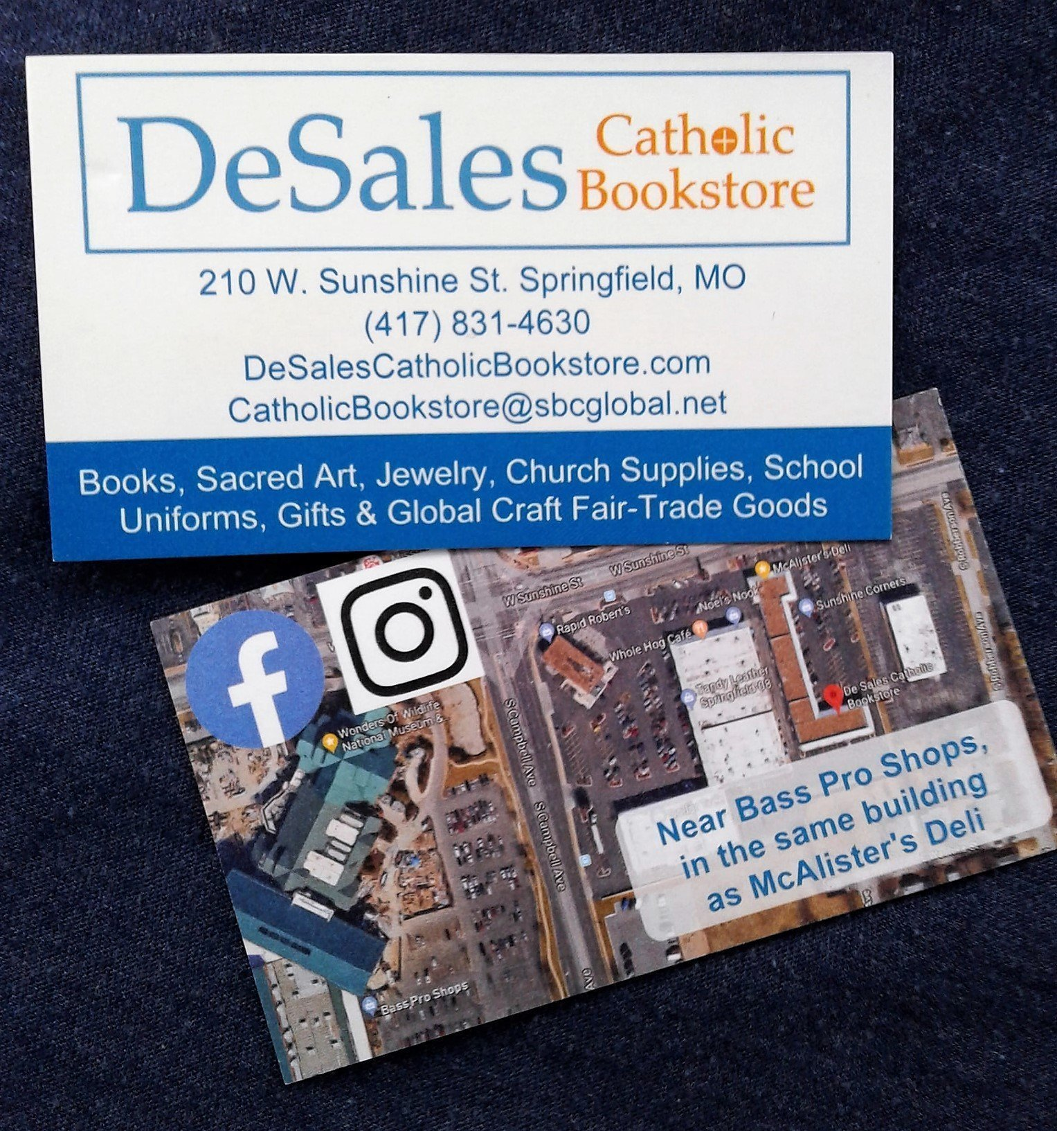 A sample of business card design. The business contact info is on the front and a map to the store is on the back.